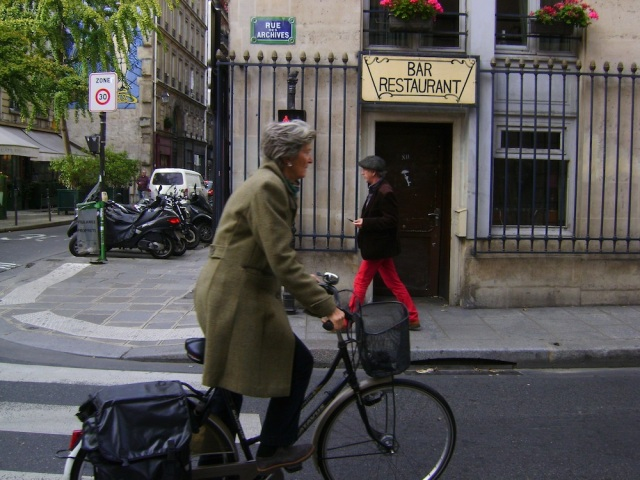 Biking along Rue de Archives. Photo: Craig Nelson